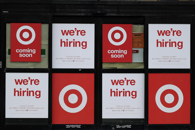 Hiring signs are displayed at a Target store in Chicago, Thursday, May 28, 2020. Thirty-seven major U.S. companies hiring now to meet coronavirus demand. (AP Photo/Nam Y. Huh)