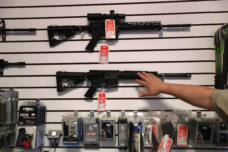 "A gun shop owner displays AR-15 ""Sport"" rifles in 2016 in Benson, Arizona. (Photo: John Moore/Getty Images)"
