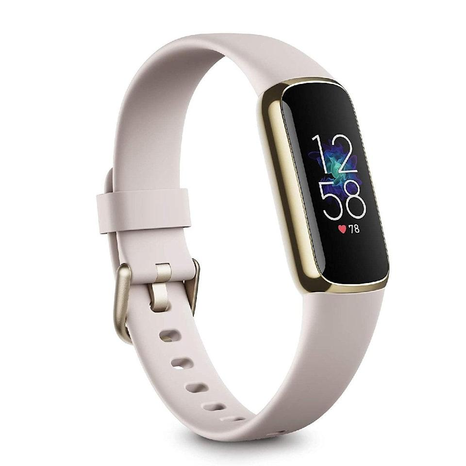 """Active moms will love the Fitbit Luxe, a minimalist <a href=""""https://www.glamour.com/gallery/best-fitness-tracker-for-women?mbid=synd_yahoo_rss"""" rel=""""nofollow noopener"""" target=""""_blank"""" data-ylk=""""slk:fitness tracker"""" class=""""link rapid-noclick-resp"""">fitness tracker</a> that's ideal for keeping track of basic workout info (think step count, pace, and heart rate) without being annoyingly bulky on the wrist. $150, Amazon. <a href=""""https://www.amazon.com/dp/B08ZF5WCC2/ref=twister_B092CMKSYY"""" rel=""""nofollow noopener"""" target=""""_blank"""" data-ylk=""""slk:Get it now!"""" class=""""link rapid-noclick-resp"""">Get it now!</a>"""