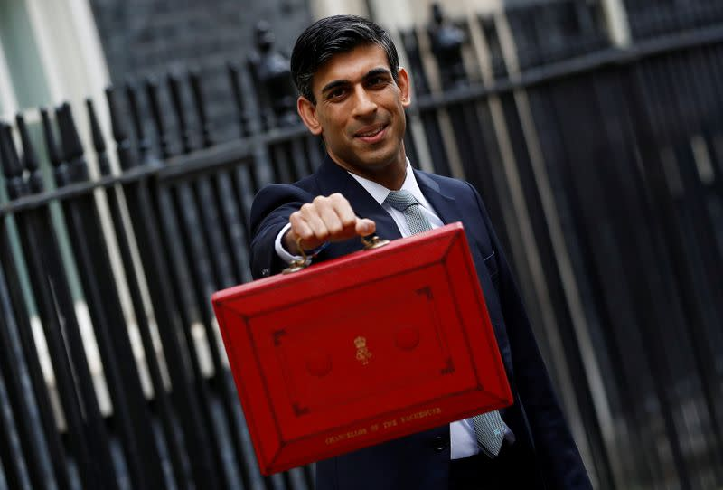FILE PHOTO: Britain's Chancellor of the Exchequer Rishi Sunak holds the budget box outside his office in Downing Street in London