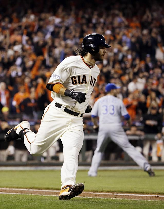 San Francisco Giants' Brandon Crawford hits an RBI single during the fourth inning of Game 5 of baseball's World Series against the Kansas City Royals Sunday, Oct. 26, 2014, in San Francisco. (AP Photo/David J. Phillip)