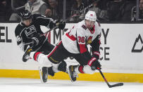 Ottawa Senators center Colin White, right, and Los Angeles Kings center Blake Lizotte fall as White tries to pass the puck during the first period of an NHL hockey game Wednesday, March 11, 2020, in Los Angeles. (AP Photo/Mark J. Terrill)