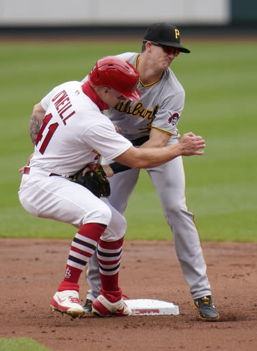 St. Louis Cardinals' Tyler O'Neill (41) is out as he collides with Pittsburgh Pirates second baseman Kevin Newman during the second inning in the first game of a baseball doubleheader Thursday, Aug. 27, 2020, in St. Louis. (AP Photo/Jeff Roberson)