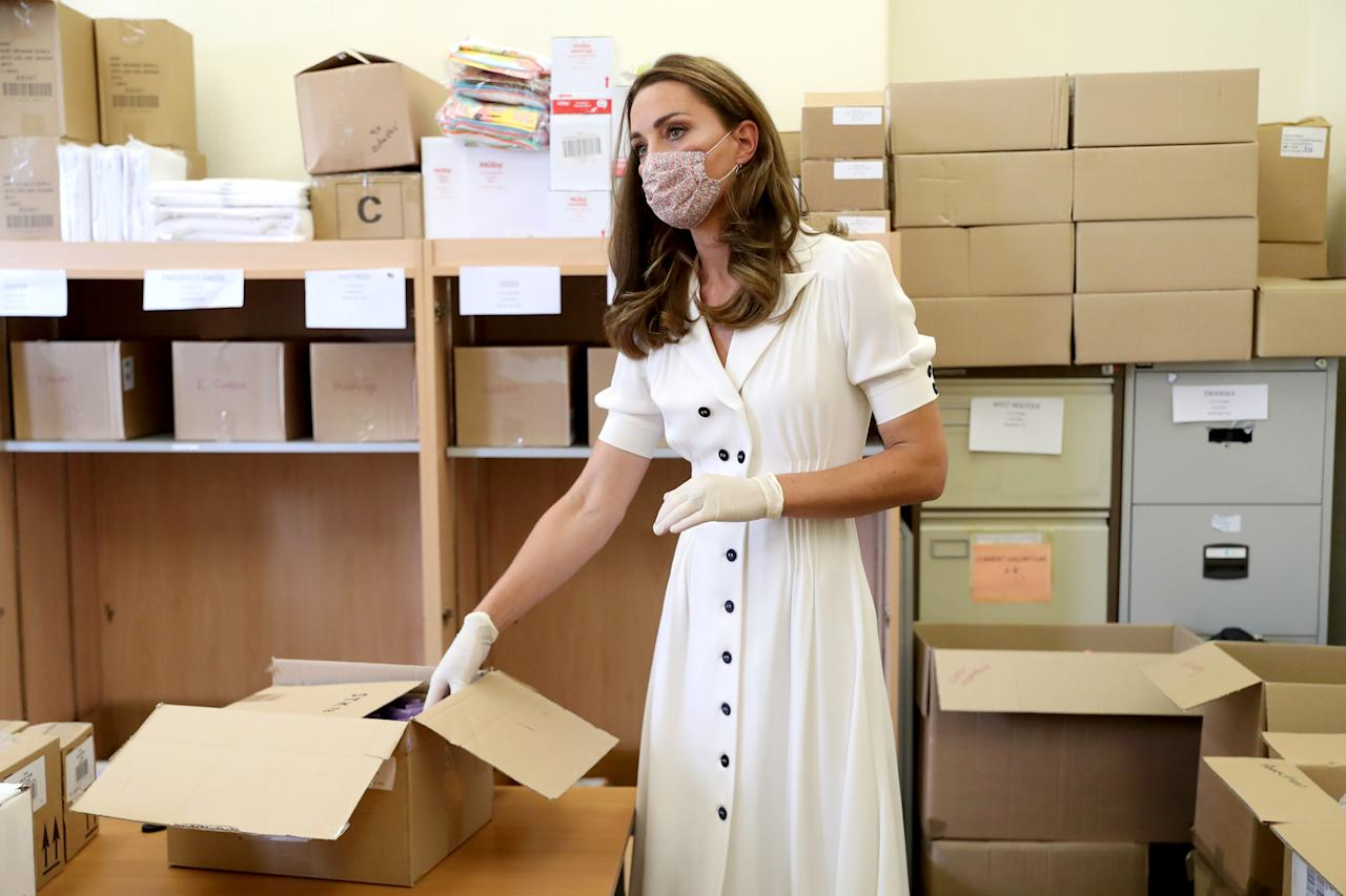 EMBARGOED TO 2200 TUESDAY AUGUST 4 The Duchess of Cambridge, wearing a face mask, helps to unpack supplies during a visit to Baby Basic UK & Baby Basics Sheffield. Baby Basics is a volunteer project supporting families in need struggling to provide for their newborns.
