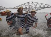 Swimmers in fancy dress splash as they participate in the New Year's Day Loony Dook swim at South Queensferry, Scotland January 1, 2015. REUTERS/Russell Cheyne (BRITAIN - Tags: SOCIETY ANNIVERSARY)