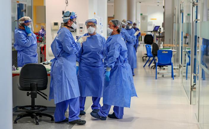 Health workers wearing full personal protective equipment (PPE) on the intensive care unit (ICU) at Whiston Hospital in Merseyside as they continue deal with the increasing number of coronavirus patients. (Photo by Peter Byrne/PA Images via Getty Images)