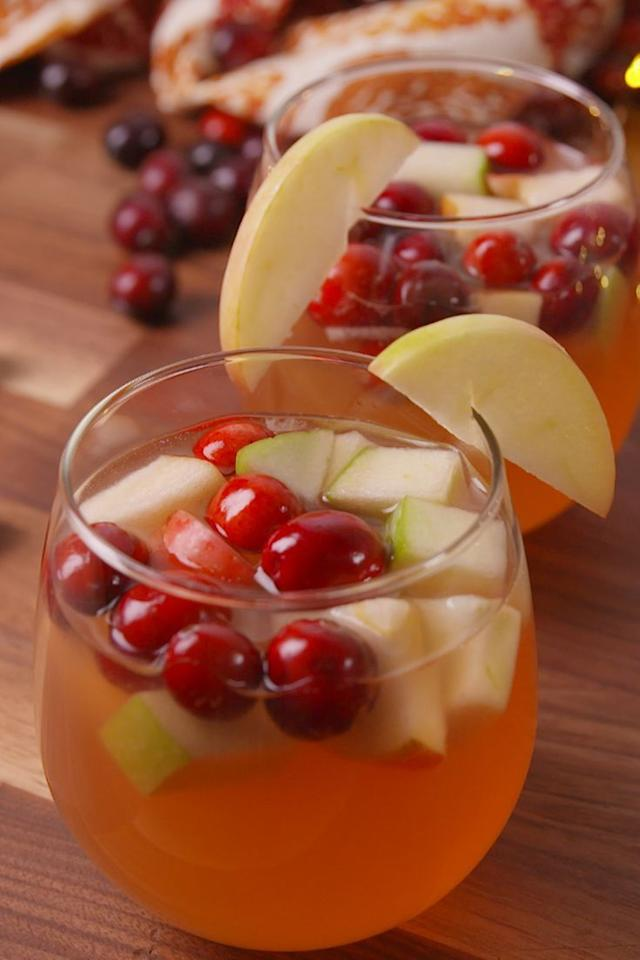 """<p>Get the recipe from <a href=""""https://www.delish.com/cooking/recipe-ideas/recipes/a50192/cran-apple-sangria-recipe/"""" target=""""_blank"""">Delish</a>.</p>"""