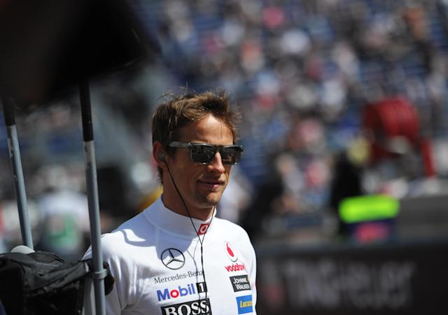 McLaren Mercedes' British driver Jenson Button stands in the pits during first practice session at the Circuit de Monaco on May 24, 2012 in Monte Carlo ahead of the Monaco Formula One Grand Prix. AFP PHOTO / DIMITAR DILKOFFDIMITAR DILKOFF/AFP/GettyImages