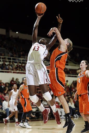 Stanford's Chiney Ogwumike (13) shoots next to Pacific's Kendall Kenyon (10) during the first half of an NCAA women's college basketball game in Stanford, Calif., Saturday, Dec. 15, 2012. (AP Photo/Marcio Jose Sanchez)