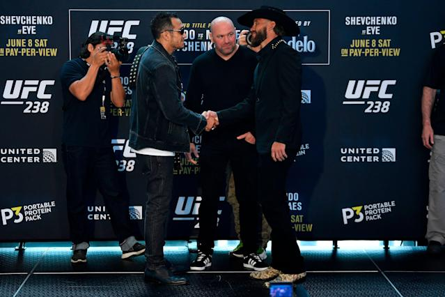 Tony Ferguson, left, and Donald Cerrone face off for the media during the UFC 238 Ultimate Media Day at the United Center on June 6, 2019, in Chicago. (Getty Images)