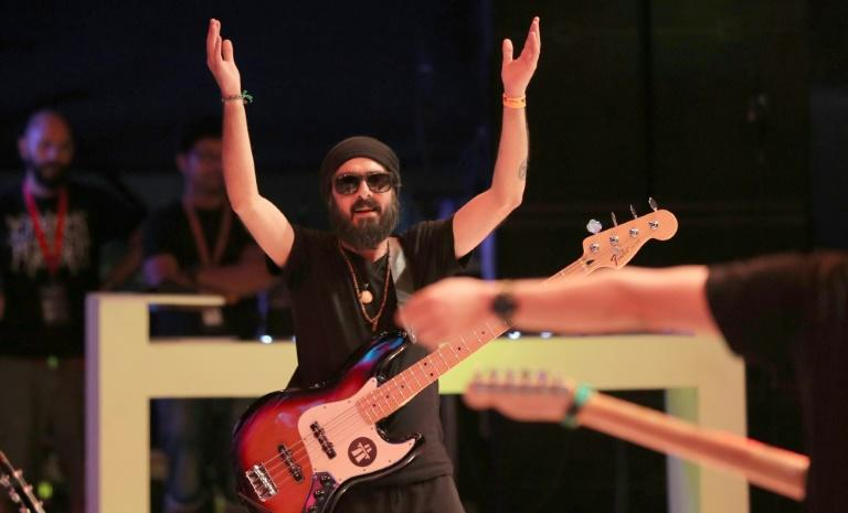 Avo Demerjian, bassist and back-up vocalist of Jordanian band Autostrad, performs on stage at the Dubai International Marine Club during a music festival, on April 7, 2017