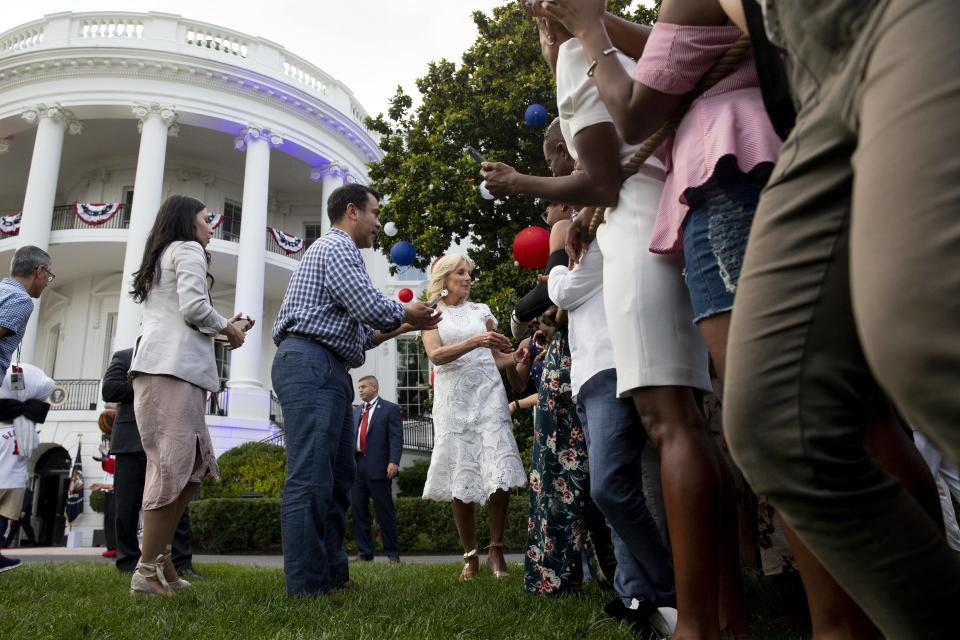 Jill Biden greets guests at an Independence Day party on the South Lawn of the White House. - Credit: Michael Reynolds - Pool via CNP / MEGA
