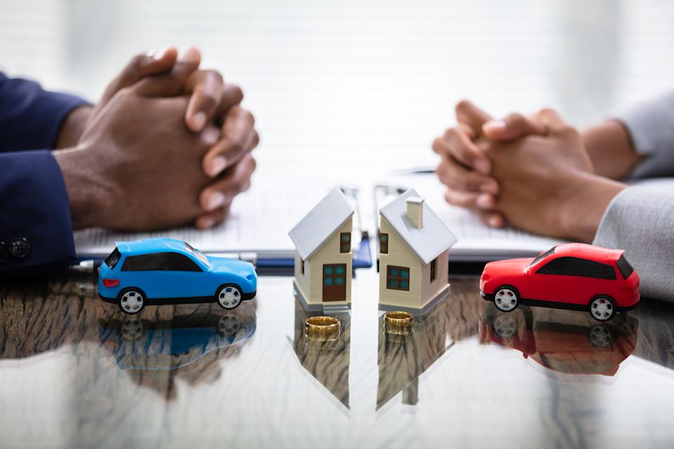 Wife And Husband Splitting House And Car During Divorce Process