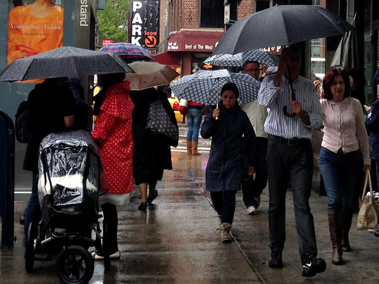 People walk with umbrellas in the rain along 9th Avenue in New York, Sunday, April 22, 2012. A spring nor'easter along the East Coast on Sunday is expected to bring rain and heavy winds and even snow in some places as it strengthens into early Monday, a punctuation to a relatively dry stretch of weather for the Northeast. The storm is atypical for April but not uncommon, said David Stark, a National Weather Service meteorologist in New York City, where 2½ to 3½ inches of rain are expected in the city with wind gusts of 25-30 mph. (AP Photo/CX Matiash)