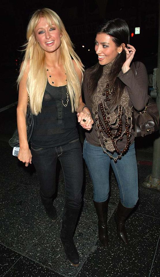 "<b>Hang With Famous Friends:</b> As she gained notoriety, the starlet also became the sidekick of her childhood friend and former ""Simple Life"" star Paris Hilton. Kim began showing up on red carpets with the hotel heiress, and apparently took a cue from her on how to play the fame game ... with no discernible talent. Following in Paris' footsteps, Kim wisely lined up her own ridiculous <a href=""http://www.youtube.com/watch?v=cYWQ5sX0-5Q"" target=""new"">Carl's Jr ad</a> intended to make salads look sexy and, more importantly, her own reality show. Chris Wolf/<a href=""http://www.filmmagic.com/"" target=""new"">FilmMagic.com</a> - January 3, 2007"