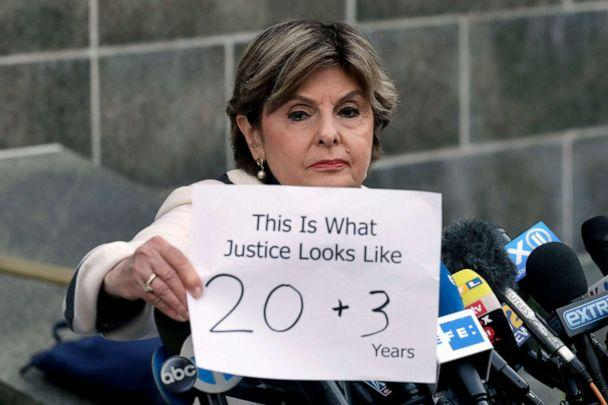 PHOTO: Attorney Gloria Allred holds a sign as she meets the press after Harvey Weinstein's sentencing, in New York, March 11, 2020. Weinstein was sentenced to 23 years in prison for rape and sexual assault. (Mark Lennihan/AP)