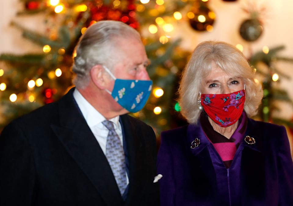 WINDSOR, UNITED KINGDOM - DECEMBER 08: (EMBARGOED FOR PUBLICATION IN UK NEWSPAPERS UNTIL 24 HOURS AFTER CREATE DATE AND TIME) Prince Charles, Prince of Wales and Camilla, Duchess of Cornwall wear a face masks as they attend an event to thank local volunteers and key workers from organisations and charities in Berkshire, who will be volunteering or working to help others over the Christmas period in the quadrangle of Windsor Castle on December 8, 2020 in Windsor, England. During the event members of the Royal Family also listened to Christmas carols performed by The Salvation Army Band. (Photo by Max Mumby/Indigo - Pool/Getty Images)