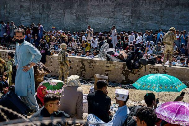 PHOTO:British and American security forces maintain outside the Abbey Gate, where Afghan evacuees crammed together waiting to be evacuated, in Kabul, Afghanistan, Aug. 25, 2021. (Marcus Yam/Los Angeles Times via Shutterstock)