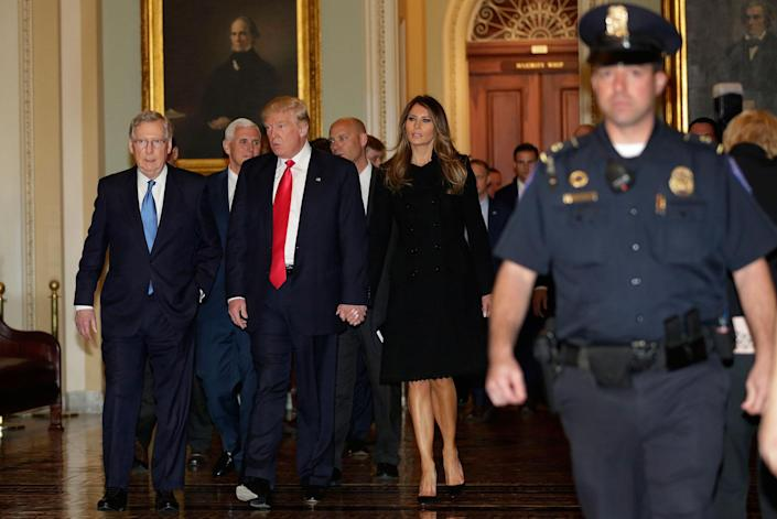 <p>President-elect Donald Trump walks with his wife, Melania, and Vice President-elect Mike Pence, second from left, before a meeting with Senate Majority Leader Mitch McConnell, left, on Capitol Hill in Washington, on Nov. 10, 2016. (Yuri Gripas/AFP/Getty Images) </p>
