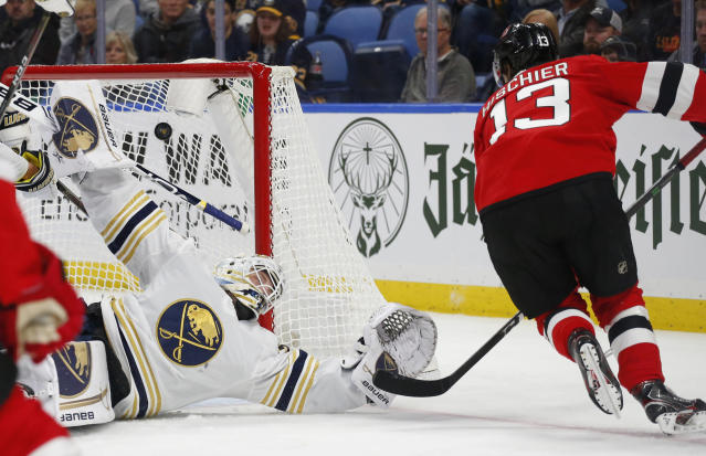 Buffalo Sabres goalie Linus Ullmark (35) is scored on by New Jersey Devils forward Nico Hischier (13) during the second period of an NHL hockey game Monday, Dec. 2, 2019, in Buffalo, N.Y. (AP Photo/Jeffrey T. Barnes)