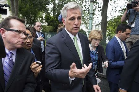 Newly elected House Majority Leader Kevin McCarthy (R-CA) speaks with reporters as he walks to the Capitol after his election in Washington June 19, 2014. REUTERS/Joshua Roberts