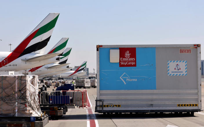 Image: An Emirates Airlines Boing 777 plane carrying a vaccine shipment at Dubai International Airport earlier this month. (Karim Shaib / AFP - Getty Images file)