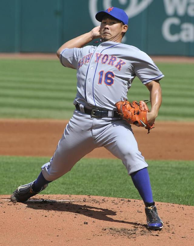 New York Mets pitcher Daisuke Matsuzaka throws to a Cleveland Indians batter during the first inning of a baseball game in Cleveland, Sunday, Sept. 8, 2013. (AP Photo/Phil Long)