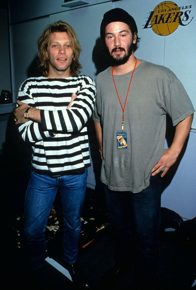 Reeves backstage at a concert for his band Dogstar with Jon Bon Jovi.
