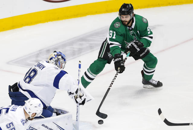 Dallas Stars forward Tyler Seguin (91) reaches for a rebound off of Tampa Bay Lightning goaltender Andrei Vasilevskiy (88) during the first period of an NHL hockey game, Tuesday, Jan. 15, 2019, in Dallas. Tampa Bay won 2-0. (AP Photo/Brandon Wade)