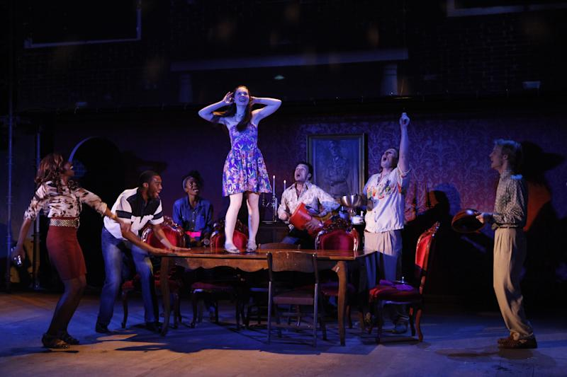 """This undated theater image released by The O and M Co. shows, from left, Shamika Cotton, Tyler Jacob Rollinson, Marsha Stephanie Blake, Shannon Garland, Lee Osorio, Brandon Coffey, and David Coomber in a scene from Woody Harrelson & Frankie Hyman's """"Bullet for Adolf,"""" at New World Stages in New York. (AP Photo/The O and M Co., Carol Rosegg)"""