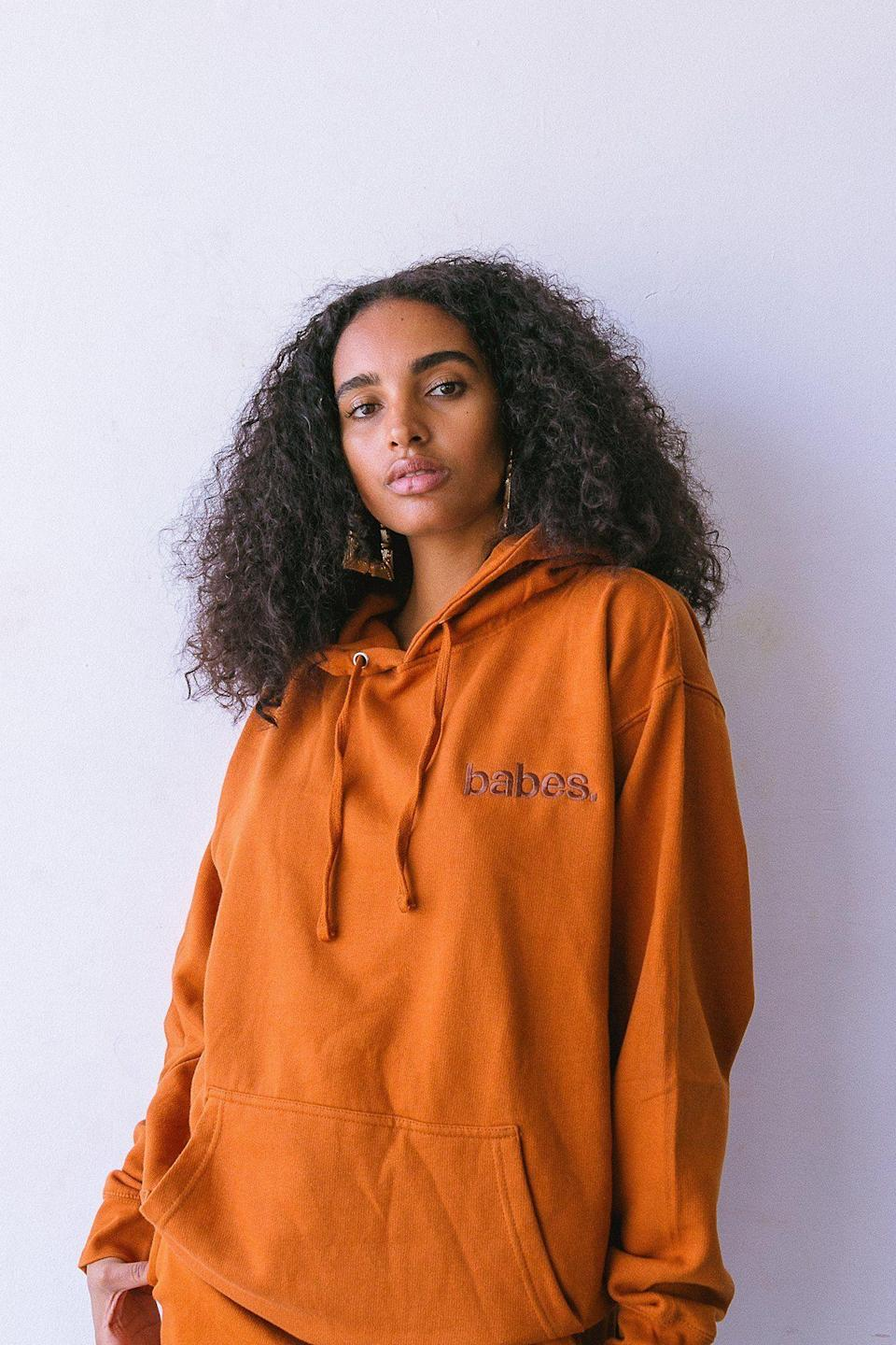 "<p><strong>Babes.</strong></p><p>shopbabes.com</p><p><strong>$45.00</strong></p><p><a href=""https://shopbabes.com/collections/joggers/products/babes-comfy-hoodie-rust"" rel=""nofollow noopener"" target=""_blank"" data-ylk=""slk:Shop Now"" class=""link rapid-noclick-resp"">Shop Now</a></p><p>If the brand name is any indication, you'll be a true babe in this perfectly baggy sweatshirt. </p>"