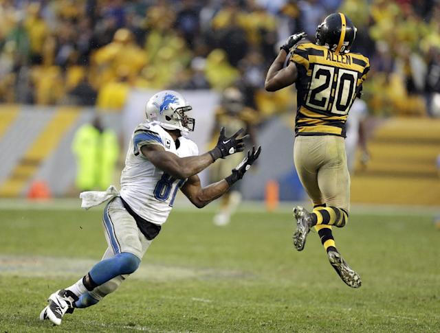 Pittsburgh Steelers strong safety Will Allen (20) intercepts a pass intended for Detroit Lions wide receiver Calvin Johnson (81) in the second half of an NFL football game in Pittsburgh, Sunday, Nov. 17, 2013. (AP Photo/Gene J. Puskar)