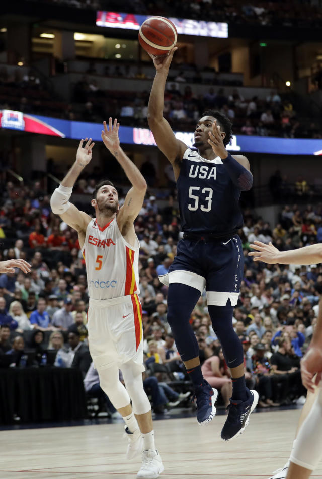 United States' Donovan Mitchell, right, shoots over Spain's Rudy Fernandez during the second half of an exhibition basketball game Friday, Aug. 16, 2019, in Anaheim, Calif. (AP Photo/Marcio Jose Sanchez)