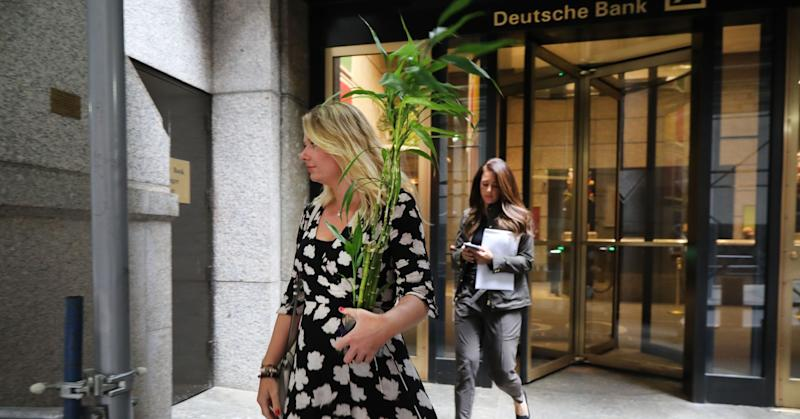 People exit Deutsche Bank's Manhattan headquarters with some of their belongings following news that the global banking giant will be letting go of thousands of employees due to a major restructuring at the German bank on July 08, 2019 in New York City. The bank has announced that it will reduce its workforce by 18,000 people in Asia, Europe and America.
