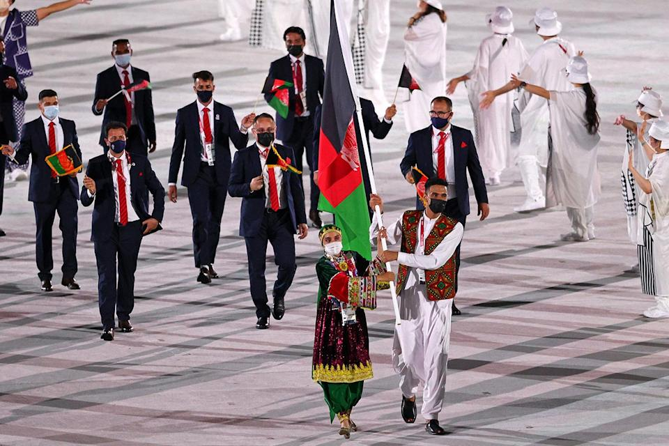 <p>Afghanistan's flag bearers wore intricate, gorgeous outfits to represent their country. </p>