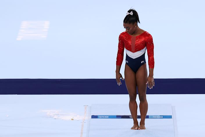 <p>TOKYO, JAPAN - JULY 27: Simone Biles of Team United States competes on vault during the Women's Team Final on day four of the Tokyo 2020 Olympic Games at Ariake Gymnastics Centre on July 27, 2021 in Tokyo, Japan. (Photo by Jamie Squire/Getty Images)</p>