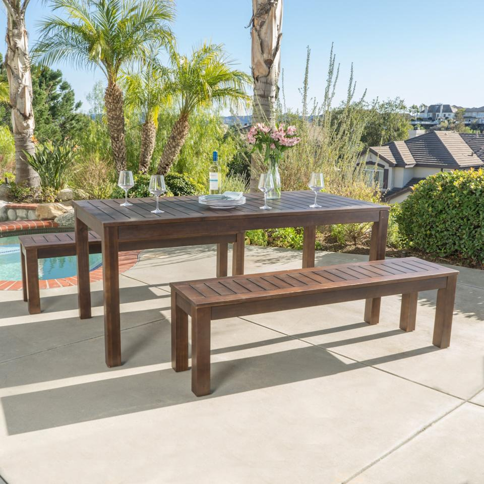 """<p><strong>Christopher Knight Home</strong></p><p>walmart.com</p><p><strong>$512.54</strong></p><p><a rel=""""nofollow"""" href=""""https://www.walmart.com/ip/266386679"""">SHOP NOW</a></p><p>This sturdy Acacia wood picnic set is a timeless piece you and your family can enjoy for years to come. Gather the whole brood for an <a rel=""""nofollow"""" href=""""https://www.womansday.com/food-recipes/g3025/best-grilled-chicken-recipes/"""">al fresco dinner</a>, or use the long table as a party buffet.</p>"""
