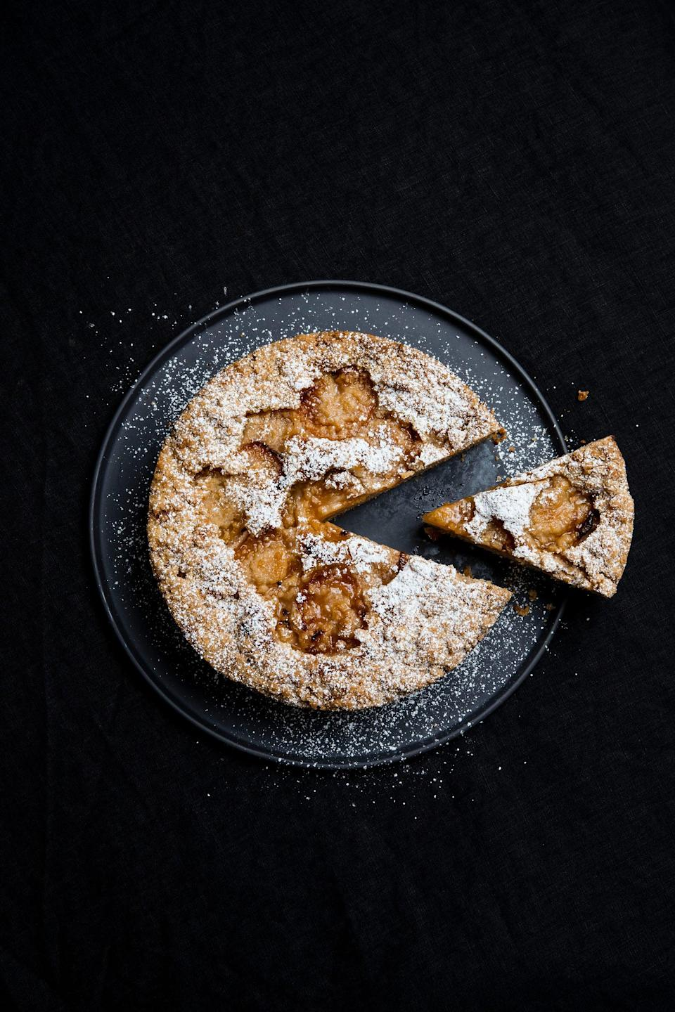 """<strong>Apricot crumble cake</strong><br><em>Serves 8–12</em><br><br><strong>Ingredients</strong><br>225 g plain flour<br>3 tsp baking powder<br>½ tsp salt<br>1 tsp ground cinnamon<br>½ tsp ground cardamom<br>115 g caster sugar<br>3 tsp <a href=""""https://www.hollandandbarrett.com/shop/product/orgran-no-egg-60072854?skuid=072854&utm_campaign=shopping&utm_medium=cpc&utm_source=google&&gclid=EAIaIQobChMIor-S-ZyO7AIVlentCh2xUwA6EAQYASABEgK67fD_BwE&gclsrc=aw.ds"""" rel=""""nofollow noopener"""" target=""""_blank"""" data-ylk=""""slk:No Egg"""" class=""""link rapid-noclick-resp"""">No Egg</a><br>80 ml cold water<br>125 g vegan butter, melted<br>125 ml vegan milk<br>1 tsp vanilla paste or extract<br>1 × 825 g tin apricot halves, drained (reserve the liquid for another use or reduce it with a little sugar and use as a syrup to drizzle over the cake)<br>icing sugar, for dusting (optional)<br><br><em>For the crumble:</em><br>60 g plain flour<br>1 tsp ground cinnamon<br>100 g caster sugar<br>55 g cold butter, cut into cubes<br><br><strong>Instructions</strong><br>1. Preheat the oven to 170°C (340°F). Grease and line the base of a 20 cm (8 in) round cake tin.<br><br>2. Sift the flour, baking powder, salt and ground spices into a bowl. Mix in the sugar.<br><br>3. In a jug, whisk together the No Egg and water, then mix in the melted butter, milk and vanilla. Pour into the dry ingredients and stir until combined (the batter will be quite thick).<br><br>4. To make the crumble, place the flour, cinnamon and sugar in a small bowl, then rub in the butter with your fingertips to make a coarse crumble.<br><br>5. Pour the batter into the prepared tin and smooth the surface. Arrange the apricots on top, cut side up, then sprinkle over the crumble. Bake for 45–55 minutes, or until a skewer inserted in the centre comes out clean.<br><br>6. Cool in the tin for 5 minutes, then carefully remove and cool completely on a wire rack. Finish with a light dusting of icing sugar if you like.<br><br>Leftovers will keep in an air"""