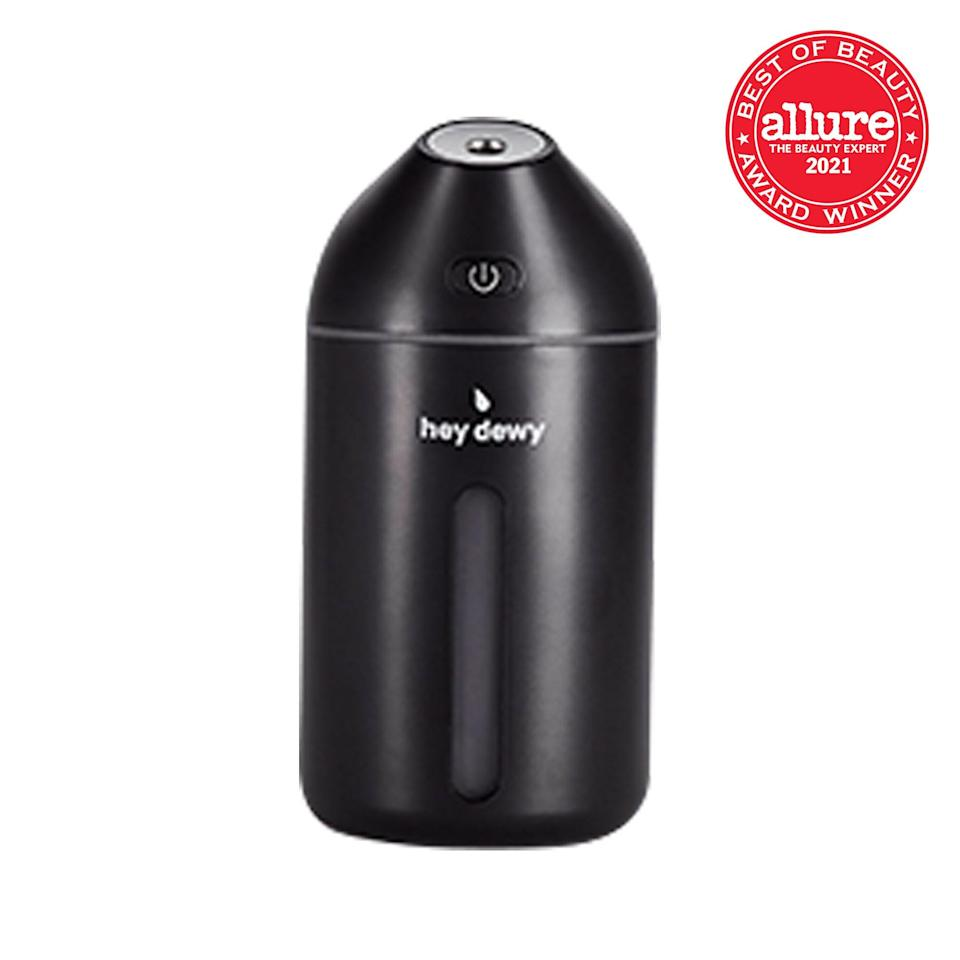 """With its compact size (think stylish soda can) and USB portability, <strong>Hey Dewy Portable Facial Humidifier</strong> <a href=""""https://www.allure.com/gallery/best-humidifiers-to-buy?mbid=synd_yahoo_rss"""" rel=""""nofollow noopener"""" target=""""_blank"""" data-ylk=""""slk:emits a hydrating mist"""" class=""""link rapid-noclick-resp"""">emits a hydrating mist</a> that goes where sheet masks can't (think Zoom meeting)."""