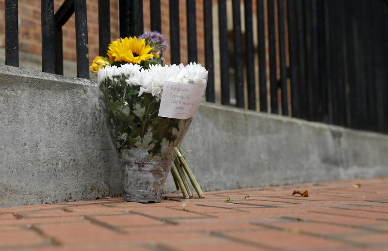 Image: Flowers left in tribute after a stabbing attack that left three people dead in Reading, England, on June 21, 2020. (Alastair Grant / AP)