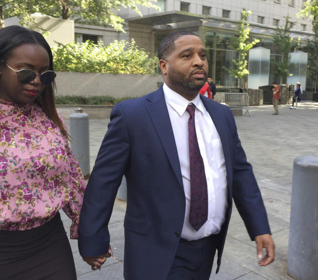 FILE - In this Oct. 10, 2017, file photo, University of Arizona assistant men's basketball coach Emanuel Richardson leaves Manhattan federal court in New York. Richardson, no longer with the team, is expected in federal court, Tuesday, Jan. 22, 2019, for a development in a criminal case in which he is charged with taking bribes from a sports agent. (AP Photo/Larry Neumeister, File)