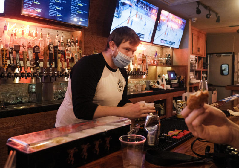 A bartender announces last call at a bar in the Short North District on July 31, 2020 in Columbus, Ohio. / Credit: Matthew Hatcher/Getty Images
