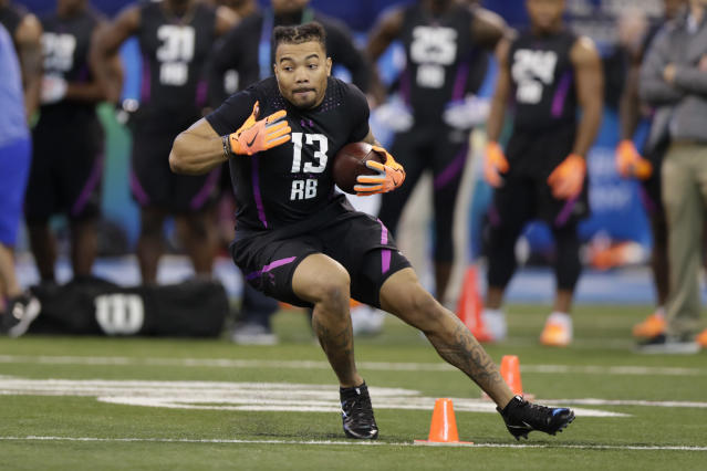 Derrius Guice, a first-round talent, was the seventh running back off the board when Washington ended his NFL draft slide late in the second round. (AP)