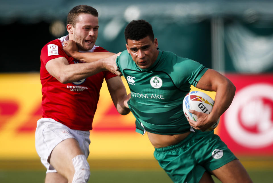 Ireland's Jordan Conroy, right, fends off Britain's Robbie Fergusson during an HSBC Canada Sevens rugby match in Edmonton, Alberta, Saturday, Sept. 25, 2021. (Jeff McIntosh/The Canadian Press)