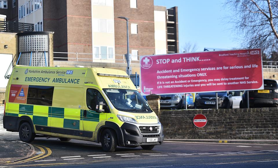 BRADFORD-ENGLAND - FEBRUARY 12: A Ambulance drives past a accident and emergency department sign outside Bradford Royal Infirmary Hospital on February 12, 2021 in Bradford, United Kingdom. With a surge of covid-19 cases fueled partly by a more infectious variant of the virus, British leaders have reimposed nationwide lockdown measures across England through at least mid February. (Photo by Nathan Stirk/Getty Images)