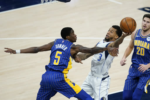Dallas Mavericks' Trey Burke (3) puts up a shot abasing Indiana Pacers' Edmond Sumner (5) during the second half of an NBA basketball game, Wednesday, Jan. 20, 2021, in Indianapolis. (AP Photo/Darron Cummings)