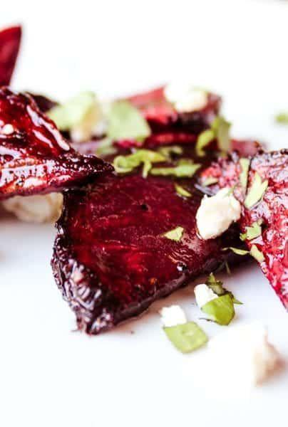 """<p>Take a cooking process generally reserved for meat, apply it to a sturdy root vegetable, and watch magic happen. These balsamic glazed smoky beets are unbelievably good.</p><p><strong>Get the recipe at <a href=""""https://www.foodfidelity.com/smoked-beets-salad/"""" rel=""""nofollow noopener"""" target=""""_blank"""" data-ylk=""""slk:Food Fidelity"""" class=""""link rapid-noclick-resp"""">Food Fidelity</a>.</strong></p><p><strong><a class=""""link rapid-noclick-resp"""" href=""""https://www.amazon.com/LANNEY-Stainless-Portable-Barbecue-Generator/dp/B07JGVBJKJ?tag=syn-yahoo-20&ascsubtag=%5Bartid%7C10050.g.34063059%5Bsrc%7Cyahoo-us"""" rel=""""nofollow noopener"""" target=""""_blank"""" data-ylk=""""slk:SHOP GRILL SMOKERS"""">SHOP GRILL SMOKERS</a><br></strong></p>"""