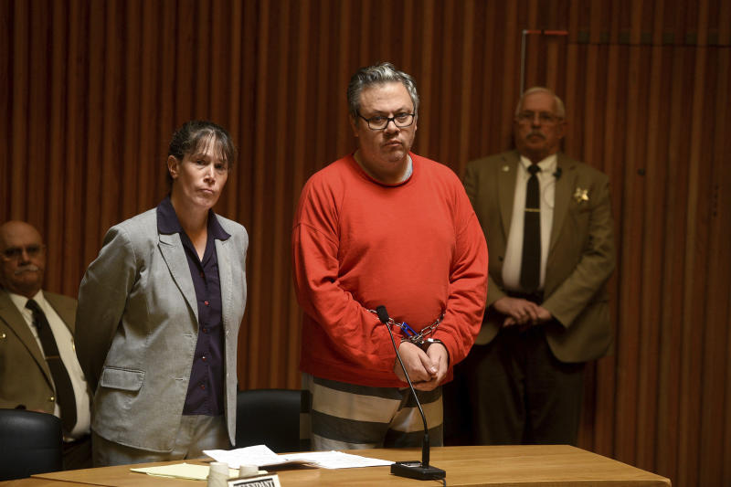 Travis Frink, of Warwick, Rhode Island, stands with his attorney, Public Defender Rebecca McKinnon, during his arraignment in Grafton County Superior Court in North Haverhill, N.H., on Sept. 13, 2017. Frink, 48, is charged with first-degree murder in the death of his 70-year-old mother, Pamela Ferriere, on Tuesday in the intensive care unit at Dartmouth-Hitchcock Medical Center in Lebanon, N.H. (Jennifer Hauck/The Valley News via AP, Pool)