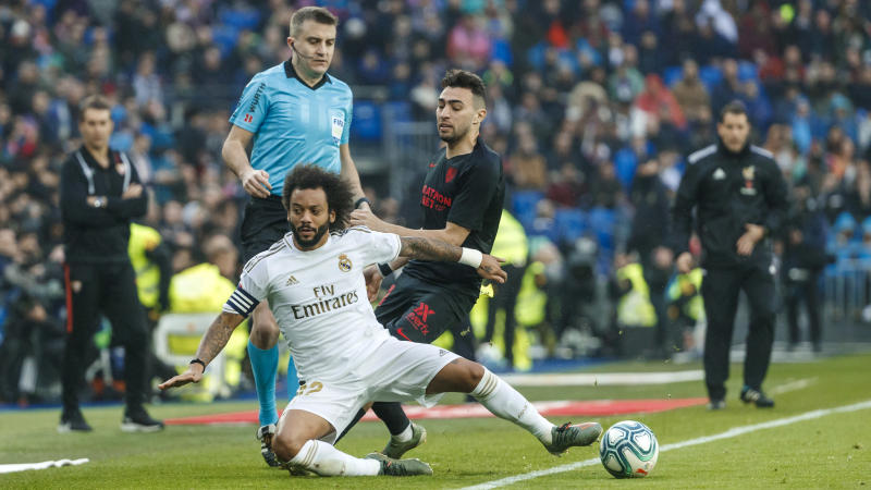 MADRID, SPAIN - JANUARY 18: (BILD ZEITUNG OUT) Marcelo Vieira of Real Madrid and Munir El haddadi of FC Sevilla battle for the ball during the Liga match between Real Madrid CF and Sevilla FC at Estadio Santiago Bernabeu on January 18, 2020 in Madrid, Spain. (Photo by TF-Images/Getty Images)