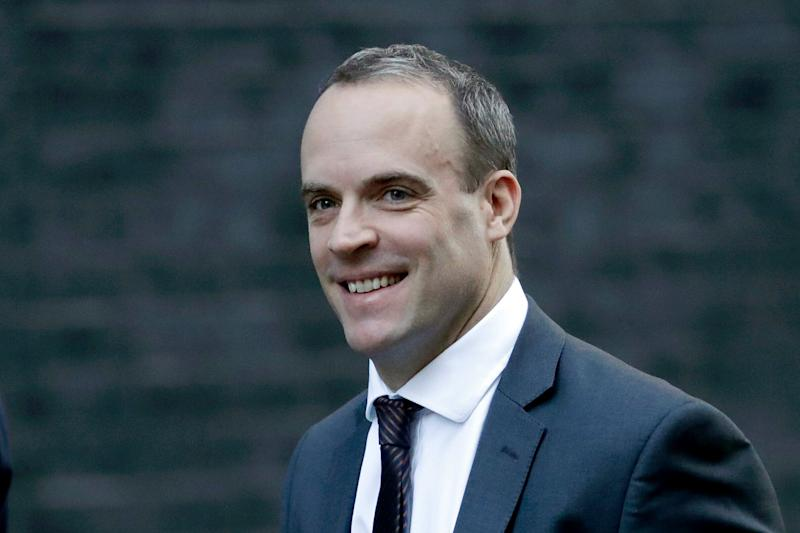 Britain's Secretary of State for Exiting the European Union Dominic Raab arrives for a cabinet meeting at 10 Downing Street in London, Tuesday, Nov. 13, 2018. (AP Photo/Matt Dunham)